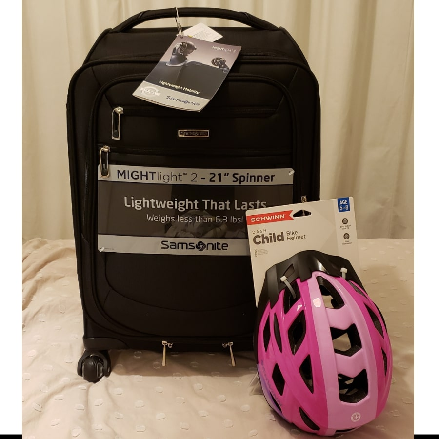 products-purchased-suitcase-and-bike-helmet